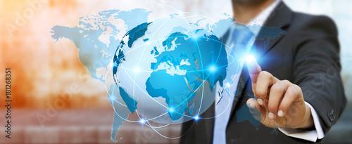 Businessman touching global network on planet earth 3D rendering Fototapet
