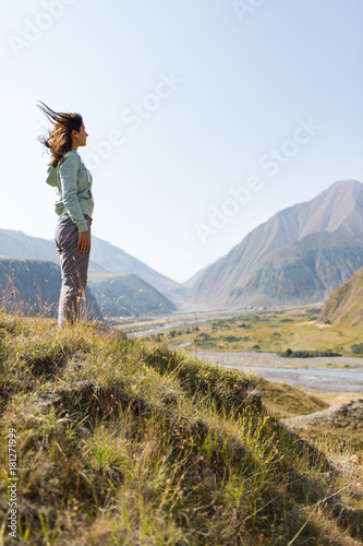 woman admires the view of the mountains