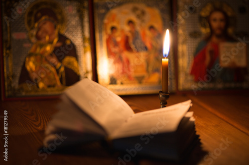 burning candle in a dark room, orthodox Wallpaper Mural