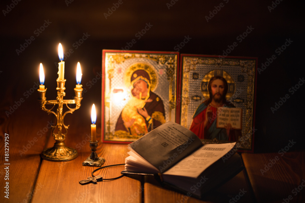 Fototapeta burning candle in a dark room, orthodox