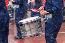Drummer Marching In Christmas Parade In The Snow
