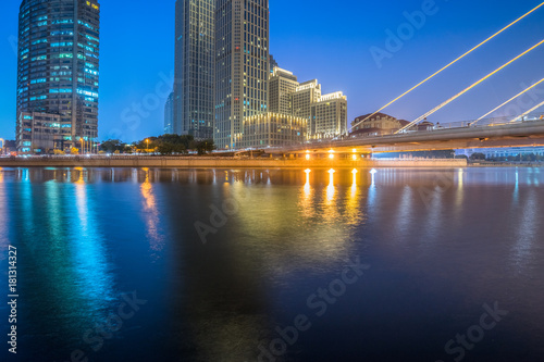 Foto  Tianjin Hai river waterfront downtown skyline with modern bridge
