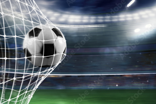 Foto op Plexiglas Bol Soccer ball scores a goal on the net