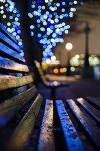 Lights Reflection On A Bench. ...