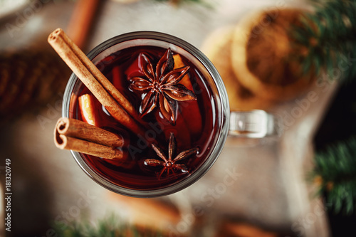 Poster Thee Christmas hot mulled wine in a glass with spices and citrus fruit. Mulled wine with cinnamon, anise and orange