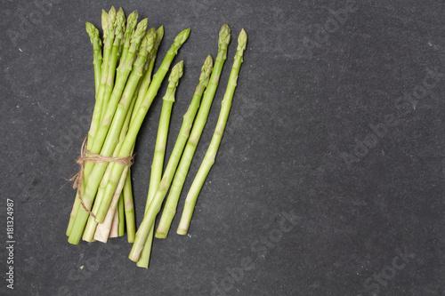 Poster Muguet de mai bunch of asparagus over slate