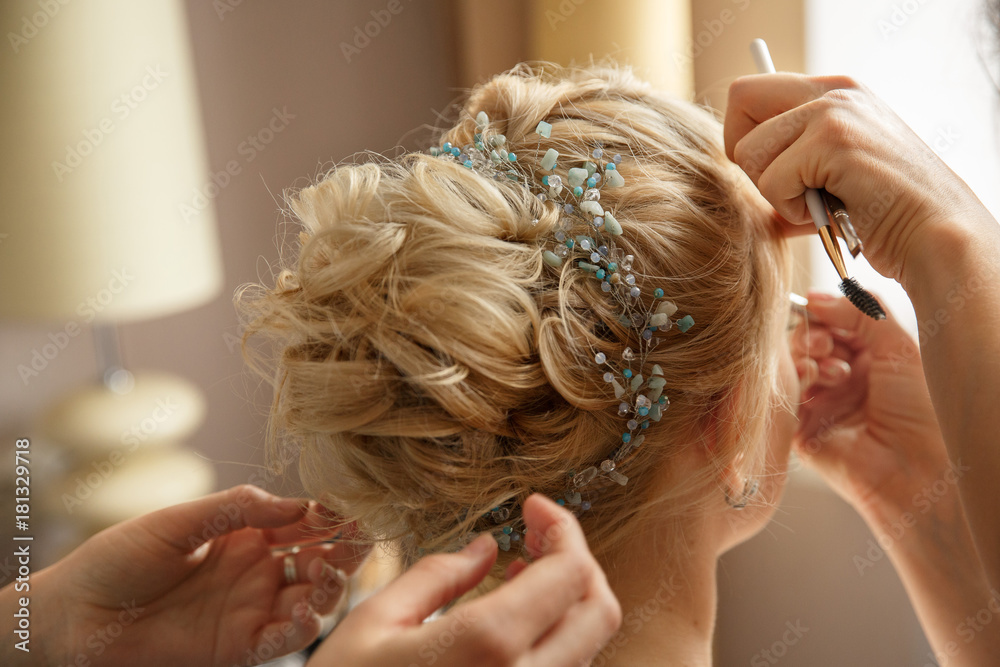 Fototapety, obrazy: Wedding hairstyle and makeup. Makeup artist made makeup for beautiful bride at wedding day