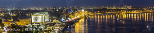 Staande foto Kiev Kyiv (Kiev) city, the capital of Ukraine at night beside the Dnipro (Dniepr) river with reflection in water