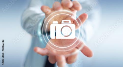 Poster Pharmacie Businessman using modern camera application 3D rendering