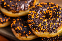Chocolate Covered Donuts With Sprinkles