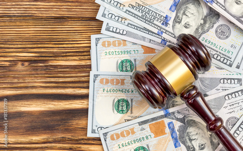 Obraz Judge's gavel with dollar bills on the table. Top view. - fototapety do salonu