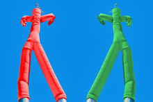 Two Inflatable Man. Green And Red. Choices Concept