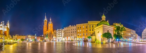 Night view of the rynek glowny main square with the church of Saint Mary and church of Saint Adalbert in the polish city Cracow/Krakow.