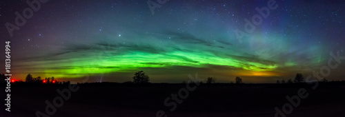 Plakaty Green arc of aurora borealis in Estonia sky