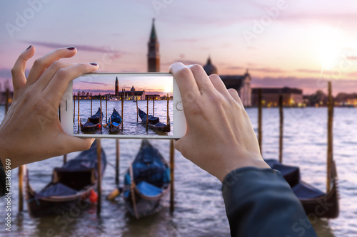 Fotografie, Obraz  First person perspective point of view hands holding smartphone capturing footag