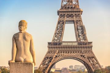 Fototapeta Paryż Woman stone statue in the Trocadero garden, Eiffel tower in the background, Paris France