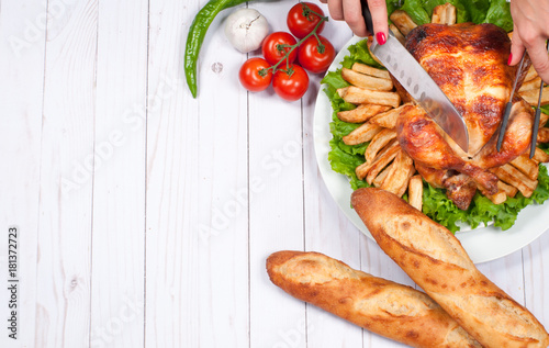 Fotografie, Obraz  Homemade  roasted whole turkey on wooden table for Thanksgiving.