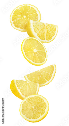 Isolated lemon slices in the air. Cut lemon fruit falling isolated on white background with clipping path