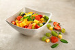 Bowl of fresh fruit salad on table