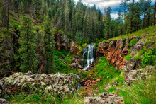 Mountain Waterfall In Forest