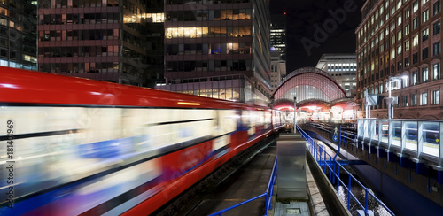 London Canary Wharf night scene with moving traffic
