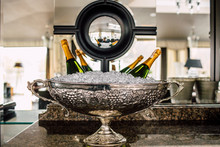 Bottles Of Champagne In Cooler.
