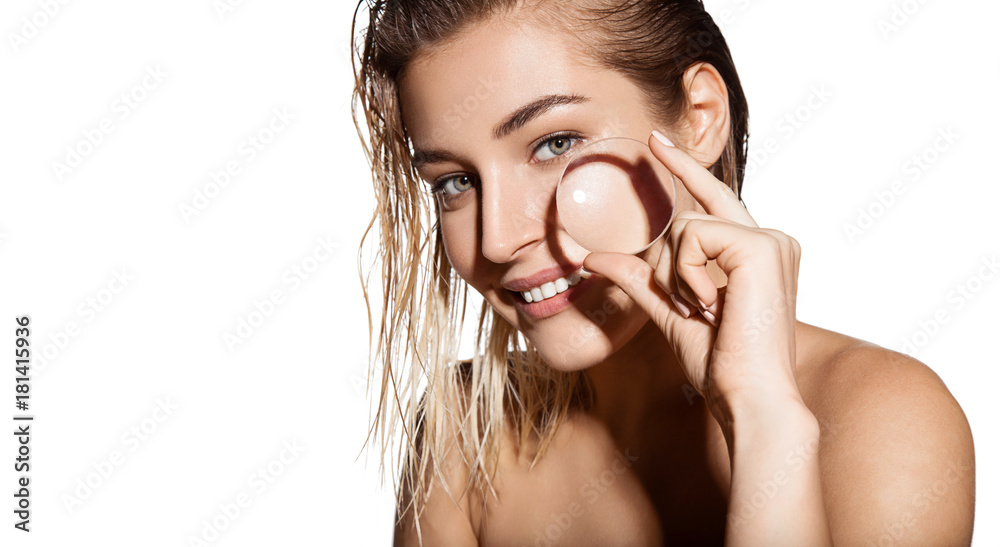 Fototapeta Glamour portrait of beautiful woman model with magnifying glass in her hands. Concept of healthy and beautiful skin. Beauty skin care, facial treatment and cosmetology concept.