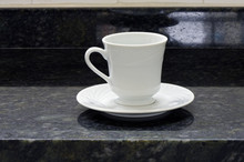 Porcelain Cup And White Saucer...