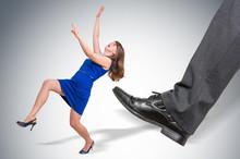 Businessman Big Foot Kicking Small Business Woman