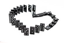Separation Or Breaking Up The Love (black Dominoes In The Form Of Hearts Fall In A Domino Effect On White Background)