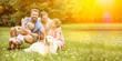 canvas print picture - Glückliche Familie mit Kinder und Hund im Garten
