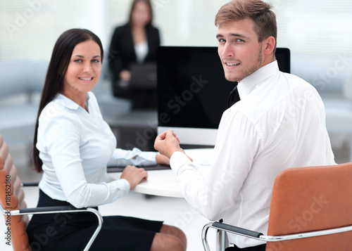 Fototapety, obrazy: members of the business team sitting at Desk and looking at camera .
