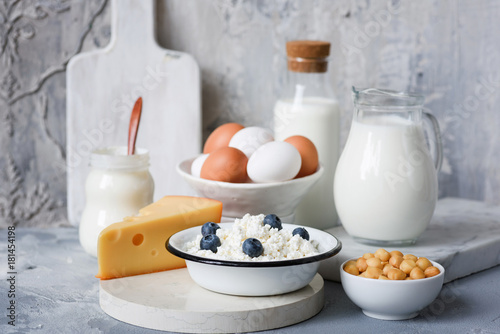 Keuken foto achterwand Zuivelproducten Dairy products on marble table over concrete background. Cheese, farmers cheese, milk, yogurt, sour cream, eggs and smoked cheese. Organic farmers dairy products