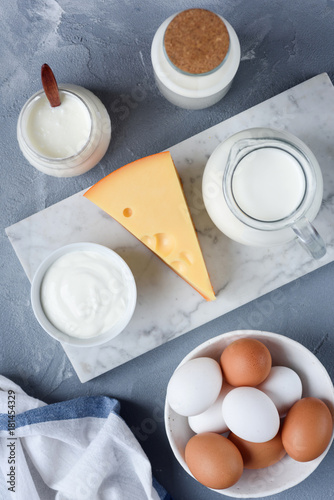 Foto op Aluminium Zuivelproducten Selection of dairy products on marble background. Eggs, Cheese, Milk, Yogurt, Sour cream and Cream. Top view