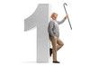 Mature man holding a cane and leaning against a cardboard number one