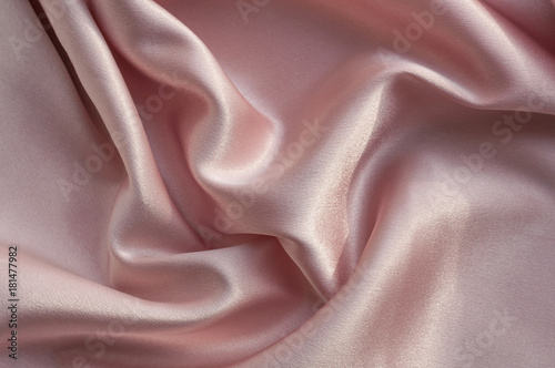 Valokuva  rich powdery pink satin folded fabric background