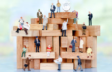 Miniature Business People Sitting On Wood Block , Recruitment Finding Employee And Business Concept.