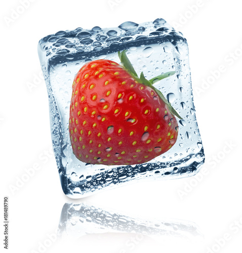 Strawberry frozen in ice cube, isolated
