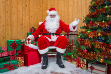 Santa Claus In A Grotto Handing Out Presents.