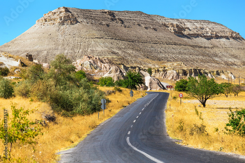 Poster Turquie An ideal asphalt road in summer Cappadocia, concept of auto travel