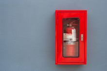 Fire Extinguisher In Red Cabinet On Gray Wall At External Buildings.