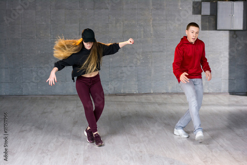 couple of hip hop dancers is dancing girl and boy performing street