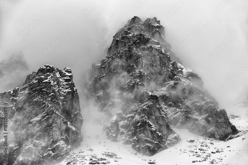 Fototapeta Fog in top of the rocky peaks