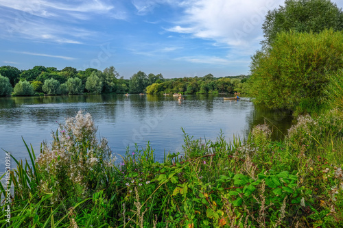 Photo  Boats on the lake in a country park on a summer day.