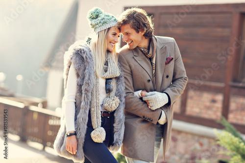 Fototapeta Happy couple walking outdoors in winter obraz