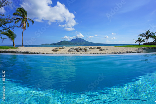 Tropical beach View of the Nevis Peak on Nevis Island across the water from St Kitts
