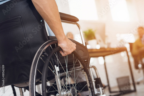 Photo  A disabled man is sitting in a wheelchair.