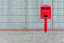 Red Mail Box On Cement Floor W...