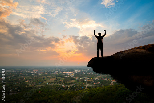Papiers peints Budapest Silhouette man standing on top of the mountain at sunset