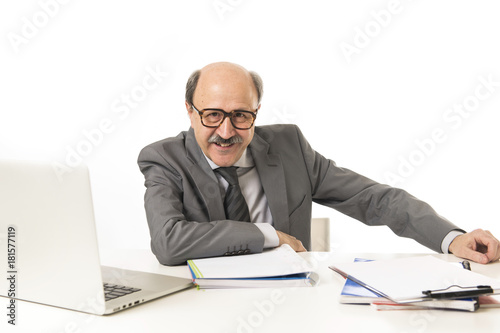 Garden Poster corporate portrait of 60s bald happy business man smiling confident and satisfied sitting at computer laptop office desk working